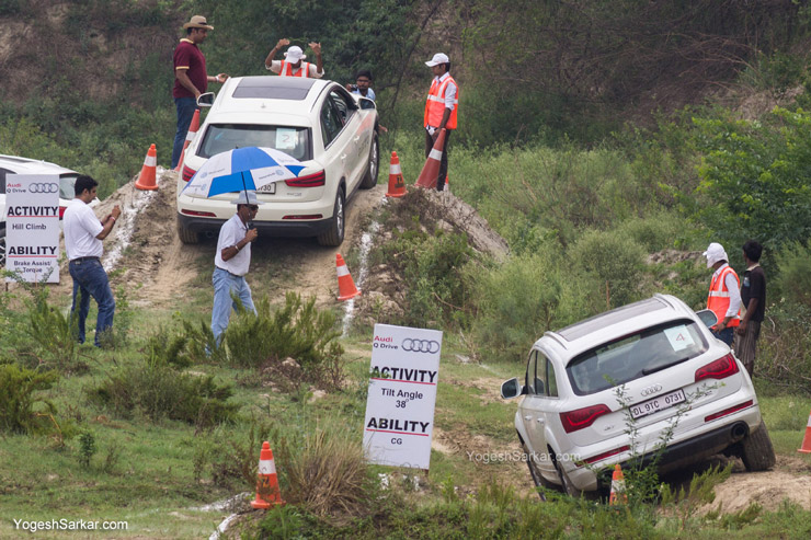 Audi Q7 following its little sister, Q3 through the off road track.